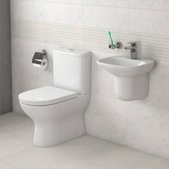 white toilet and wall hung basin