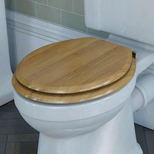 white toilet with oak toilet seat