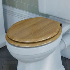 white toilet with oak toilet seat