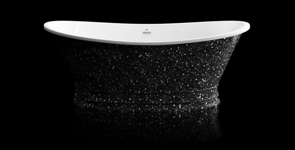 Black and white speckled Balthus freestanding bath on a on a black background with reflection on a shiny floor; side on