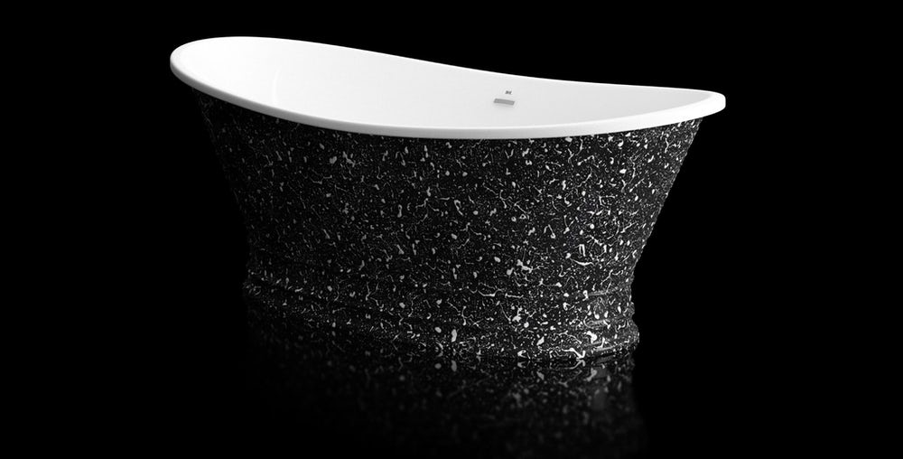 Black and white speckled Balthus freestanding bath on a on a black background with reflection on a shiny floor; angled