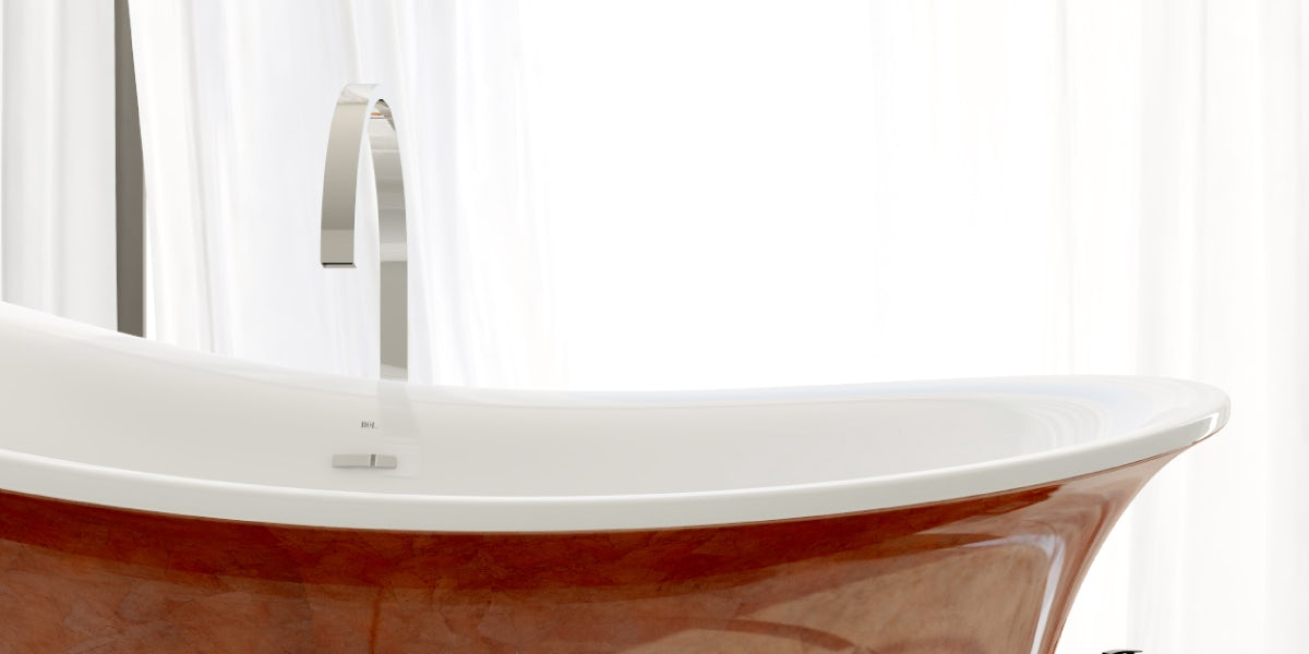 A close-up image of the red Fontana freestanding bath with a contemporary Avanzi tall freestanding tap