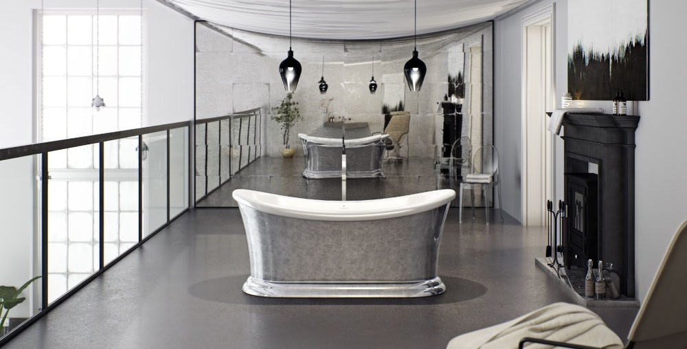 Metallic silver leaf coated Charlet freestanding bath on a balcony with grey floor facing a traditional fireplace