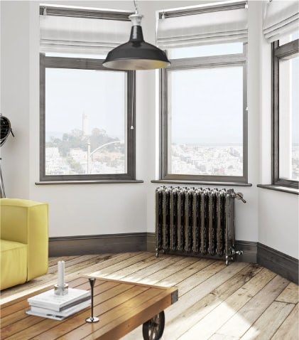 A Terma Oxford freestanding cast iron radiator