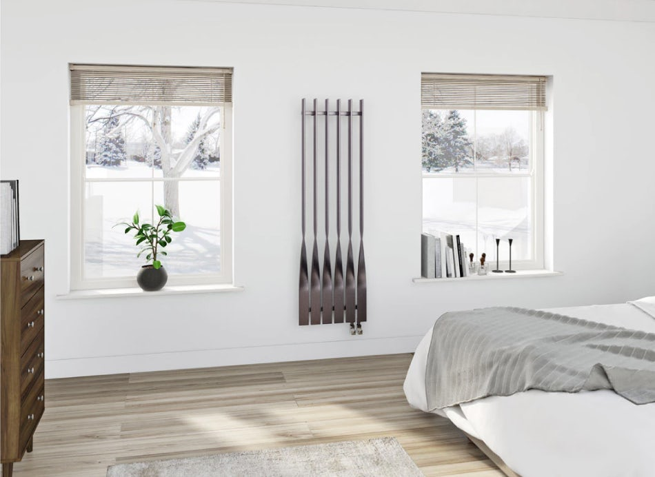 Bedroom with a Terma radiator on the wall