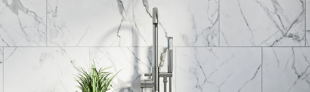 Contemporary marble-effect wall tiles with chrome tap in front of it