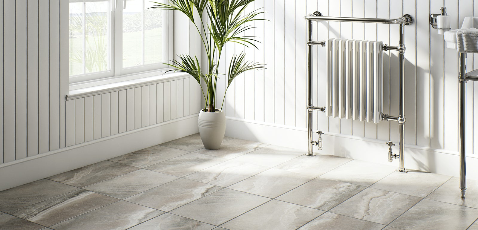 A black cast-iron radiator attached to a white-brick effect tiled wall