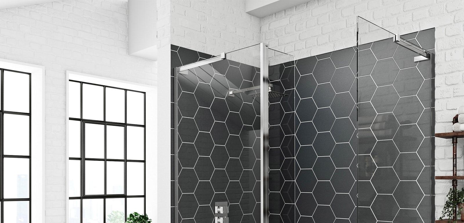 Wet room glass panels with black hexagonal tiles