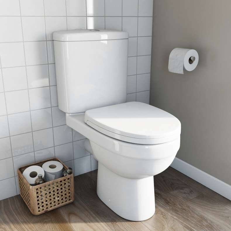 Energy close coupled toilet with soft close toilet seat