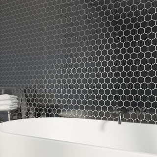 bathroom with shower and black mosaic wall tiles