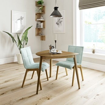 Ernest oak apartment table with 2 x Hadley light green dining chairs