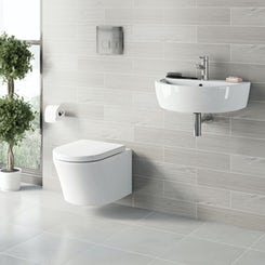 Arc hung toilet and wall hung basin suite