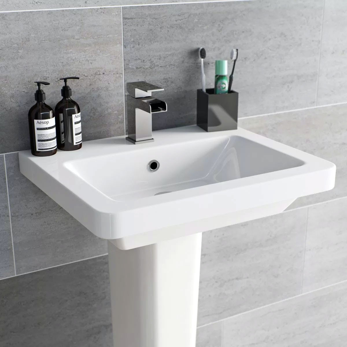 bathroom basin with grey tiled background