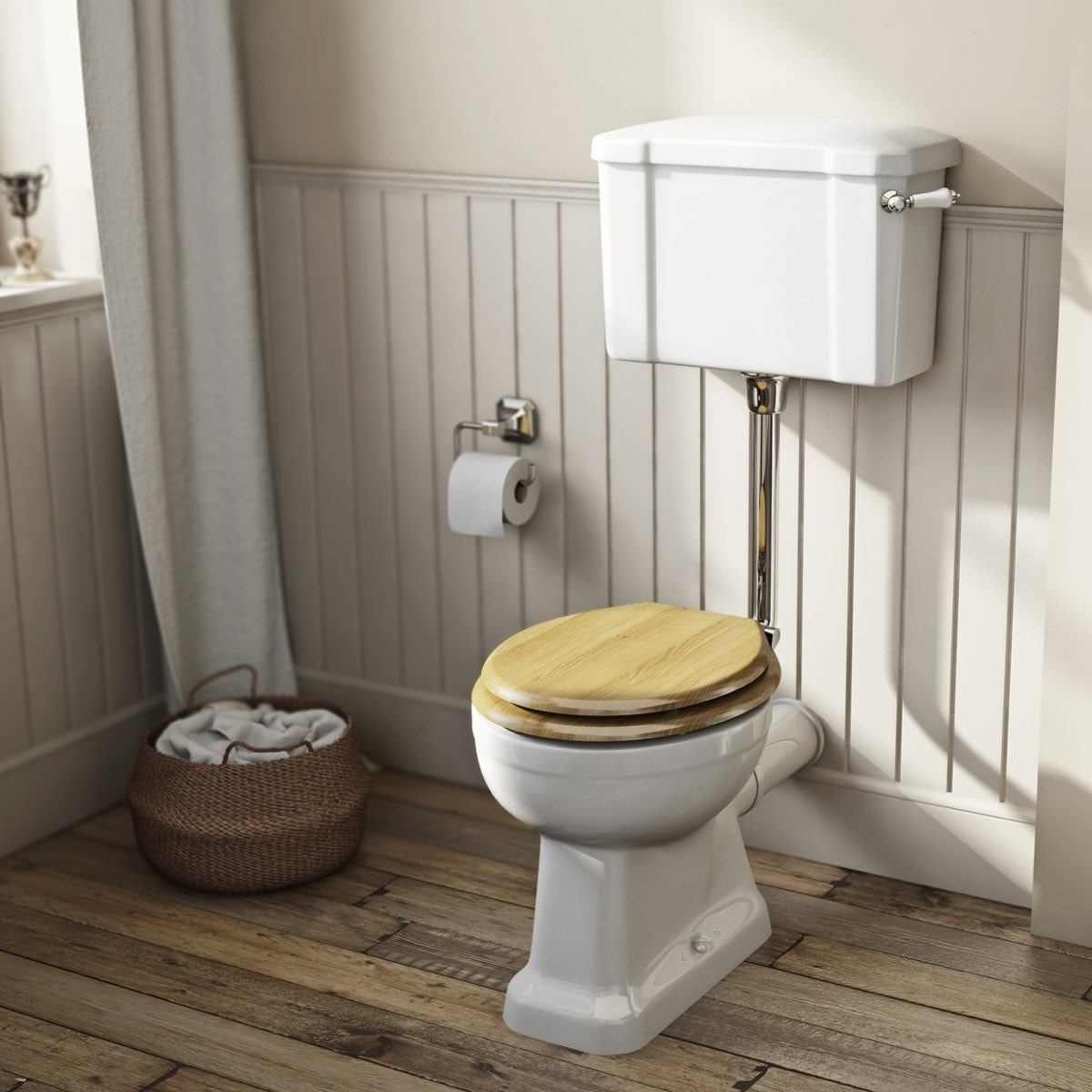 The Bath Co. Camberley low level toilet with wooden soft close seat oak effect