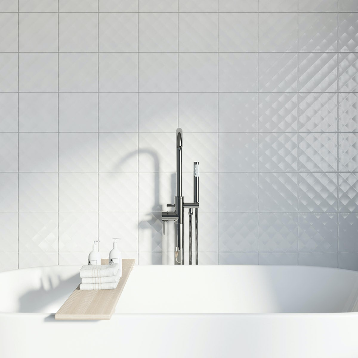 wall tiled with white ridged tiles and low hanging lamp