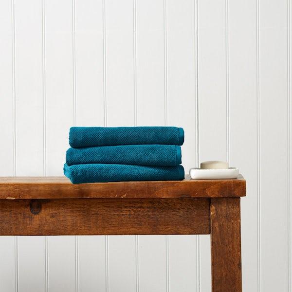 Christy Brixton peacock hand towel