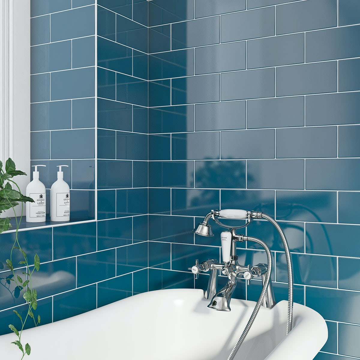 navy blue metro gloss tile with bath and tap