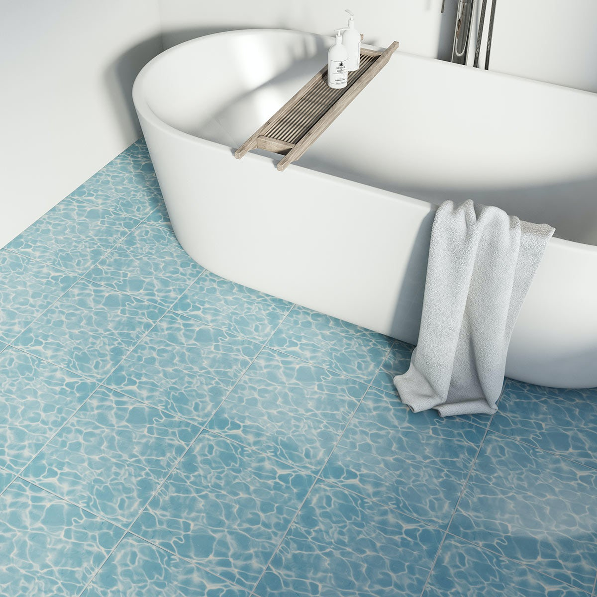bath on a floor tiled with water effect tiles